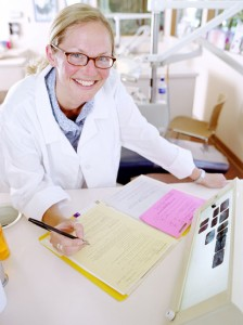 Smiling nurse at desk